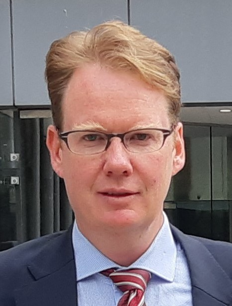 Man in suit with glasses